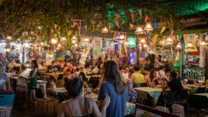 People in an open air restaurant at night time © Syed Ahmad